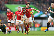 Dan Biggar of Wales makes a break. Rugby World Cup 2015 quarter final match, South Africa v Wales at Twickenham Stadium in London, England  on Saturday 17th October 2015.<br /> pic by  John Patrick Fletcher, Andrew Orchard sports photography.