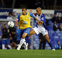 Photo: Mark Stephenson.<br /> Birmingham City v Hereford United. Carling Cup. 28/08/2007.Herefords Lionel Ainsworth wins the ball from Birminghams Mrhdi Nafi