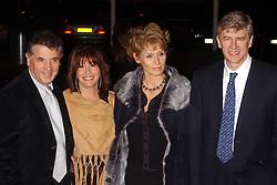 David Dein (left) the Vice Chairman of Arsenal football club with wife Barbara (2nd left), and Manager Arsene Wenger (right) with his partner Annie arrive at the BBC TV Centre in Wood Lane, West London, for the BBC Sports Personality Awards.