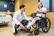 Dr. Darryl L. Kaelin, photographed Wednesday, June 3, 2015 at the Frazier Rehab Institute in Louisville, Ky., works with patient Arnold Johnston. Dr. Kaelin is the medical director of the Frazier Rehab Institute and an associate professor at the University of Louisville and Chief of Physical Medicine and Rehabilitation in the Department of Neurological Surgery. (Photo by Brian Bohannon)