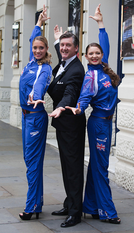 """© Licensed to London News Pictures. 30/06/2012. London, England. L-R: Jenna Randall, Robin Cousins and Olivia Federici. Olympic Gold Medallist Robin Cousins poses with Jenna Randall and Olivia Federici from Team GB's Synchronised Swimming Team, whom he mentors. Robin Cousins will take up the role of """"Billy Flynn"""" in the musical Chicaco at the Garrick Theatre from 17 July 2012 for a limited season. Photo credit: Bettina Strenske/LNP"""
