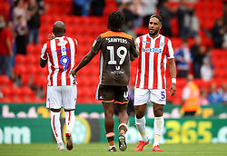 Brentford's Romaine Sawyers (centre) and Stoke City's Ashley Williams (right) after the match