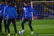 AFC Wimbledon midfielder Ethan Chislett (11) warming up prior to kick off during the EFL Sky Bet League 1 match between AFC Wimbledon and Peterborough United at Plough Lane, London, United Kingdom on 2 December 2020.