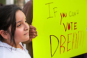 15 AUGUST 2012 - PHOENIX, AZ:  A girl whose father is an undocumented immigrant in front of the Arizona State Capitol Wednesday. About 200 people, mostly DREAM Act  (an acronym for Development, Relief, and Education for Alien Minors) students and their family members, marched on the Arizona State Capitol in Phoenix Wednesday after Arizona Governor Jan Brewer said the state of Arizona will not give DREAM Act students any state services, including driver's licenses or tuition breaks on state universities and schools. Brewer has been a critic of President Obama's plan to defer deportations of certain undocumented young people.  PHOTO BY JACK KURTZ