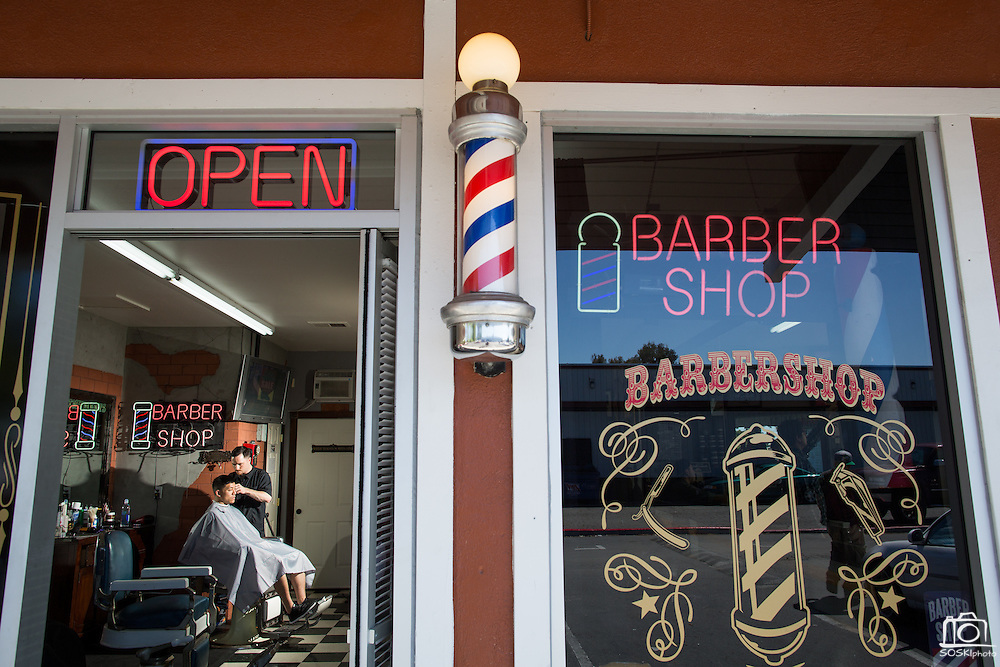 Garrison Finkes trims a customer's hair at Alex's Classic Barber Shop & Shaves in Fremont, California, on April 9, 2014.  Finkes has been a barber at Alex's Barber Shop for more than three years. (Stan Olszewski/SOSKIphoto)
