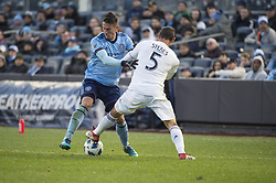 March 11, 2018 - Bronx, New York, United States - Los Angeles Galaxy defender DANIEL STERES (5) steals the ball from New York City FC defender BEN SWEAT (2) during a regular season match at Yankee Stadium in Bronx, NY.  NYCFC defeats LA Galaxy 2 to 1. (Credit Image: © Mark Smith via ZUMA Wire)