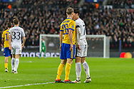 Juventus defender Stephan Lichtsteiner and Tottenham Hotspur forward Son Heung-Min argue during the Champions League match between Tottenham Hotspur and Juventus FC at Wembley Stadium, London, England on 7 March 2018. Picture by Toyin Oshodi.