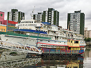 """Docked in La Boca, the Vapor de la Carrera ship formerly ferried daily between Buenos Aires and Montevideo, and now houses an art gallery and restaurant. In La Boca barrio (neighborhood) of Buenos Aires, tourists are attracted by colorful houses, the Caminito pedestrian street, La Ribera theatre, tango clubs, and Italian taverns. La Boca retains a strong European flavor, with many early settlers from Genoa, Italy. It sits at the mouth (""""boca"""" in Spanish) of the Matanza River (or Río Mataderos, or Riachuelo which simply means ?Creek?). La Boca is known among sports fans for La Bombonera stadium (Estadio Alberto J. Armando), home of Boca Juniors, one of the world's best known football (soccer) clubs. As a centre for radical politics, La Boca elected the first socialist member of the Argentine Congress (Alfredo Palacios in 1935) and hosted many demonstrations during the crisis of 2001 in Argentina, South America."""