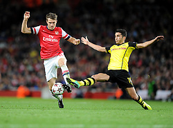 Borrusia Dortmund's Nuri Sahin stretches to tackle Arsenal's Aaron Ramsey- Photo mandatory by-line: Alex James/JMP - Tel: Mobile: 07966 386802 22/10/2013 - SPORT - FOOTBALL - Emirates Stadium - London - Arsenal v Borussia Dortmund - CHAMPIONS LEAGUE - GROUP F