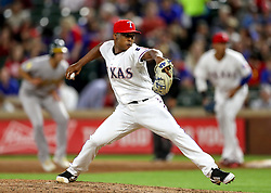 April 23, 2018 - Arlington, TX, U.S. - ARLINGTON, TX - APRIL 23: Texas Rangers relieve pitcher Jose Leclerc delivers a pitch during the game between the Texas Rangers and the Oakland Athletics on April 23, 2018 at Globe Life Park in Arlington, Texas. (Photo by Steve Nurenberg/Icon Sportswire) (Credit Image: © Steve Nurenberg/Icon SMI via ZUMA Press)
