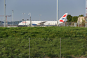 April 8, 2020, Hounslow, England, United Kingdom: British Airways plane is seen parked at Heathrow Airport Cargo station on Wednesday, April 8, 2020 - as it called on more airlines and freight companies to maximise the use of the hub's quieter flight schedule in the fight against COVID-19. Logistics companies have already begun importing key equipment such as COVID-19 testing kits via Heathrow in preparation for increased demand. Heathrow's cargo movements are forecast to increase by 53%, as more airlines and freighter operators use the available capacity to transport goods which will assist in the fight against coronavirus. (Credit Image: © Vedat Xhymshiti/ZUMA Wire)