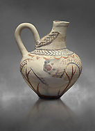 Cycladic cut away jug with floral and net pattern.   Cycladic (1650-1450 BC) , Phylakopi III, Melos. National Archaeological Museum Athens. Cat no 5757.   Gray background.<br /> <br /> <br /> This jug has a strainer in the spout with floral patterns. Ceramic shapes and painted style are heavily influenced by Minoan styles during this period. Dark floral and spiral patterns are painted over a lighted backgound with wavy bands. .<br /> <br /> If you prefer to buy from our ALAMY PHOTO LIBRARY  Collection visit : https://www.alamy.com/portfolio/paul-williams-funkystock/cycladic-art-artefacts.html Type into the LOWER SEARCH WITHIN GALLERY box to refine search by adding background colour, place, museum etc<br /> <br /> Visit our CYCLADIC CIVILISATIONS PHOTO COLLECTIONS for more photos to download or buy as wall art prints https://funkystock.photoshelter.com/gallery-collection/Cycladic-civilisation-Ancient-Greek-Artefacts-art-Photos-Pictures-Images/C0000CmevVvnC.XU