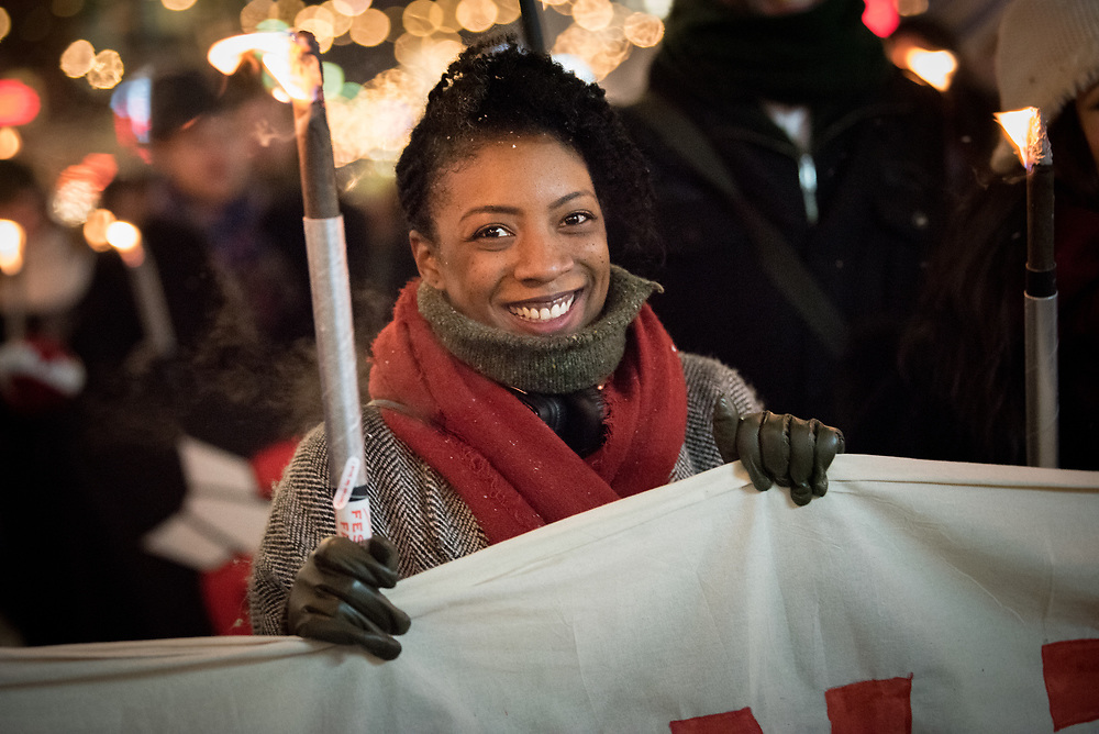 """10 December 2017, Oslo, Norway: In the evening of 10 December some 4,000 people from around the world gathered in central Oslo for a torch light march for peace. The event took place after the Nobel Peace Prize award 2017, awarded to the International Campaign to Abolish Nuclear Weapons (ICAN), for """"its work to draw attention to the catastrophic humanitarian consequences of any use of nuclear weapons and for its ground-breaking efforts to achieve a treaty-based prohibition of such weapons"""". Among the crowd were more than 20 """"Hibakusha"""", survivors of the atomic bombings in Hiroshima and Nagasaki, as well as a range of activists, faith-based organizations and others who work or support work for peace, in one or another way. Here, Hayley Ramsay-Jones from Soka Gakkai International. Soka Gakkai is a worldwide Buddhist network which promotes peace, culture and education through personal transformation and social contribution. It is a Japanese religious movement founded in 1930."""