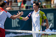 Japan's Kei Nishikori shakes hands with USA's Jack Sock following their men's singles match at the Citi Open ATP tennis tournament in Washington, DC, USA, 1 Aug 2013. Nishikori won the match 7-5, 6-2 to advance.