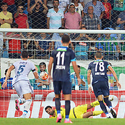 Caykur Rizespor's Ahmet Ilhan (M)and Fenerbahce's goalkeeper Volkan Demirel (M) during their Turkish Super League soccer match Caykur Rizespor between Fenerbahce at the Yeni Rize Sehir stadium in Rize Turkey on Sunday, 23 August 2015. Photo by TVPN/TURKPIX
