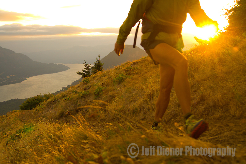 A young woman hikes along the Dog Mountain Trail in the Columbia River Gorge, Washington.