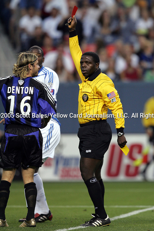 4 July 2005: Referee Abiodun Okulaja presents the red card to Colorado's Jean Philippe Peguero (not pictured) for a second deliberate handball - much to the chagrin of Peguero's teammate Eric Denton (16). The Colorado Rapids defeated the Kansas City Wizards 2-1 at Invesco Field at Mile High in Denver, Colorado in a Major League Soccer Regular Season Match..