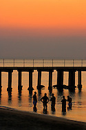 People enjoying seaside during a summer evening by a Bayside pier.<br /> <br /> Larger JPEGs and TIFF file available  Contact EFFECTIVE WORKING IMAGE.via our contact page at : www.photography4business.com.