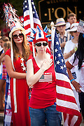A woman dressed in patriotic costume stands for the flag in the I'On Community 4th of July parade.