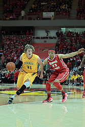 22 January 2014:  Ron Baker speeds past Zach Lofton during an NCAA Missouri Valley Conference mens basketball game between the Shockers of Wichita Stat and the Illinois State Redbirds  in Redbird Arena, Normal IL.