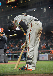 April 30, 2018 - San Francisco, CA, U.S. - SAN FRANCISCO, CA - APRIL 30: San Francisco Giants Catcher Buster Posey (28) applies  bat rosin during the San Francisco Giants and San Diego Padres game on April 30, 2018 at AT&T Park in San Francisco, CA. (Photo by Stephen Hopson/Icon Sportswire) (Credit Image: © Stephen Hopson/Icon SMI via ZUMA Press)