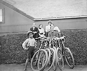 9318-01.  Young Black boy standing next to a group of bicyclists, Portland, Oregon, about 1910