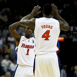 Mar 24, 2011; New Orleans, LA; Florida Gators guard Kenny Boynton (1) celebrates with forward/center Patric Young (4) during overtime of the semifinals of the southeast regional of the 2011 NCAA men's basketball tournament against the Brigham Young Cougars at New Orleans Arena. Florida defeated BYU 83-74.   Mandatory Credit: Derick E. Hingle