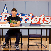 032013       Cable Hoover<br /> <br /> Miyamura Patriot Zach Shank sets up his name card as he prepares to sign a letter of intent to play football for Oklahoma Baptist University Wednesday at Miyamura High School.
