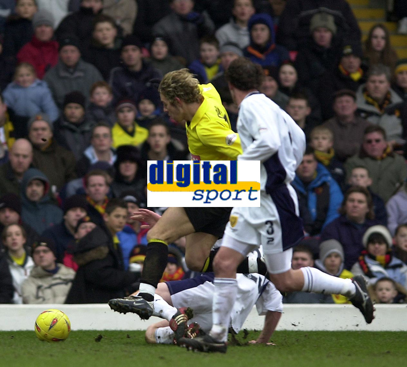 Photo. © Peter Spurrier/Sportsbeat Images<br /> 28/02/2004  -  Nationwide Div 1 Watford v Wimbledon<br /> Watford's Lee Cook breaks through down the Wimbledon defenders, to set up a second half attack.