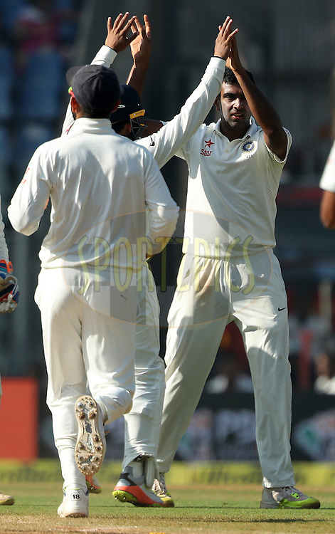 Ravichandran Ashwin of India celebrates the wicket of Chris Woakes of England during day 5 of the fourth test match between India and England held at the Wankhede Stadium, Mumbai on the 12th December 2016.<br /> <br /> Photo by: Ron Gaunt/ BCCI/ SPORTZPICS