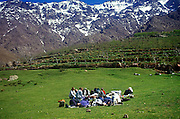 Trekking group stop for a rest surrounded by mountain peaks, Atlas Mountains, Morocco