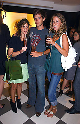 Left to right, NIKKI PENNIE, JACK FREUD and KATE MELHUISH at a party to celebrate the opening of PPQ Mayfair at 47 Conduit Street, London W1 on 18th September 2006.<br />