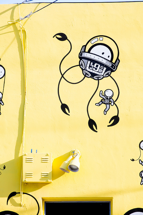 """Detail of a mural by the Amsterdam-based art collective """"The London Police"""" in Miami's Wynwood district depicts science fiction-like deep sea diving devices for little, round-faced creatures."""