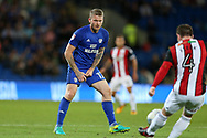 Aron Gunnarsson of Cardiff City (l)  in action.EFL Skybet championship match, Cardiff city v Sheffield Utd at the Cardiff City Stadium in Cardiff, South Wales on Tuesday 15th August 2017.<br /> pic by Andrew Orchard, Andrew Orchard sports photography.