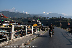 Round the World Doug Wothke heading for the peaks on day-4 our our Himalayan Heroes adventure riding from Pokhara to Kalopani, Nepal. Friday, November 9, 2018. Photography ©2018 Michael Lichter.