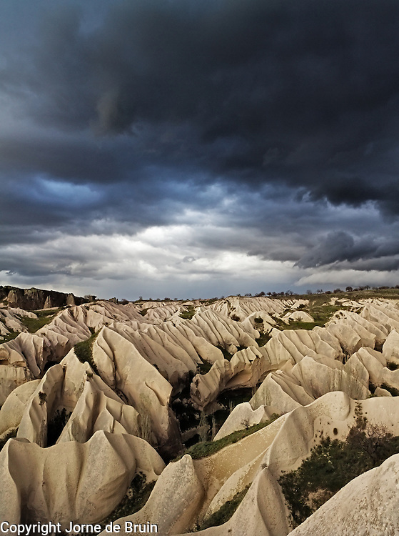 Stormclouds are forming over Rose Valley in Cappadocia, Turkey.