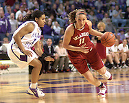Oklahoma guard Laura Andrews (R) drives against Kansas State's Twiggy McIntyre (L), during the first half at Bramlage Coliseum in Manhattan, Kansas, February 21, 2006.  The 9th ranked Sooners defeated K-State 78-64.