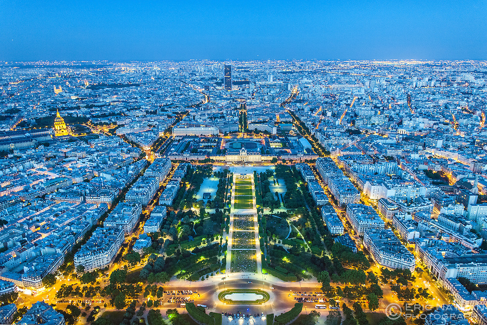 View across Paris from the top of the Eiffel Tower at dusk.