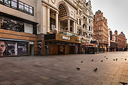 The Invisible Man poster in front of a boarded up cinema in Leicester Square in the centre of Londons cinema land, empty during the coronavirus pandemic on the 10th May 2020 in London, United Kingdom. The main headline What you cant see can hurt you has a savage irony during the COVID lockdown.