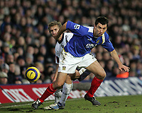 Photo: Lee Earle.<br /> Portsmouth v West Bromwich Albion. The Barclays Premiership. 17/12/2005. Portsmouth's Svetoslav Todorov (F) holds off Martin Albrechtsen.