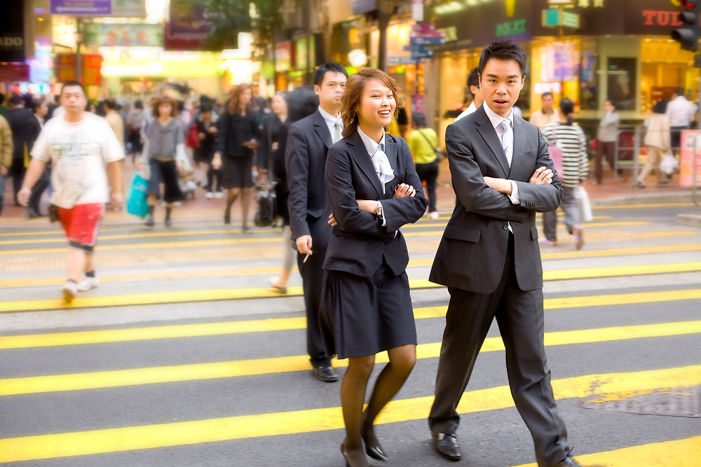 Central district, Hong Kong, China, Asia - Young executives in suits in the streets of Hong Kong