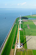 Nederland, Flevoland, Noordoostpolder, 10-10-2014. Westermeerdijk, ten noorden van Urk. Bouw van het grootste windmolenpark van Nederland, Windpark Noordoostpolder. Het windmolenpark van de Koepel Windenergie Noordoostpolder is een initiatief van NOP Agrowind, energiebedrijf RWE/Essent en Westermeerwind <br /> Construction of the largest wind farm in the Netherlands, Wind farm Northeast Polder.<br /> luchtfoto (toeslag op standard tarieven);<br /> aerial photo (additional fee required);<br /> copyright foto/photo Siebe Swart