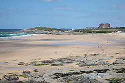 "© Licensed to London News Pictures. 11/05/2020. Newquay, UK. Fistral beach on the North coast of Cornwall is much quieter than usual, the day after British Prime Minister Boris Johnson announced a 'road map' to lift lockdown restrictions due to Covid-19, (Coronavirus). A rise in ""staycations"" - the concept of holidaying in your home country rather than travelling abroad - is expected, with many visitors planning to visit Cornwall. However, an ongoing campaign titled ""#ComeBackLater"" is trying to persuade tourists not to visit the county until it is safe to do so. Photo credit : Tom Nicholson/LNP"