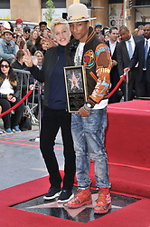 Guest Speaker Ellen DeGeneres supporting Pharrell Williams as he was Honored With A Star On The Hollywood Walk Of Fame in Hollywood, CA. The event took place on Thursday, December 4, 2014. Photo by: Sthanlee B. Mirador_Shooting Star/SIPA USA