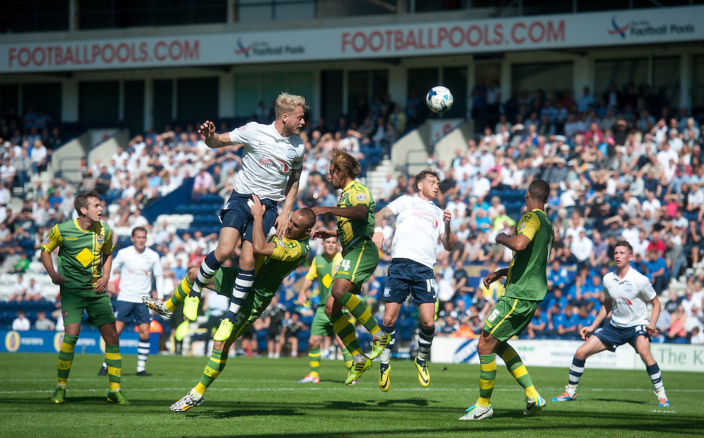Preston North End's Tom Clarke heads towards goal in a crowded penalty area<br /> <br /> Photographer Stephen White/CameraSport<br /> <br /> Football - The Football League Sky Bet League One - Preston North End v Notts County - Saturday 9th August 2014 - Deepdale - Preston<br /> <br /> © CameraSport - 43 Linden Ave. Countesthorpe. Leicester. England. LE8 5PG - Tel: +44 (0) 116 277 4147 - admin@camerasport.com - www.camerasport.com