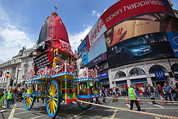 © licensed to London News Pictures. London, UK 17/06/2012. A 40-foot high colourful chariot being pulled in Piccadilly Circus as people celebrating Hare Krishna, an old Hindu tradition in central London, today (17/06/12). Photo credit: Tolga Akmen/LNP
