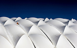 Workers on the roof covering the indoor pitch at Oriam, Scotland's Sports Performance Centre, at Heriot-Watt's Edinburgh Campus.