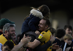 Sutton United's Rob Milsom celebrates with fans after the Sky Bet League Two match at Borough Sports Ground, Sutton. Picture date: Saturday October 9, 2021.