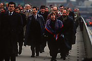 1990s rush-hour commuters cross London Bridge from Southwark on the south bank to the City of London aka The Square Mile, the capitals financial centre, on 18th February 1992, in London, England.