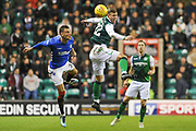Florian Kamberi beats Borna Borisic to the ball during the Ladbrokes Scottish Premiership match between Hibernian and Rangers at Easter Road, Edinburgh, Scotland on 19 December 2018.